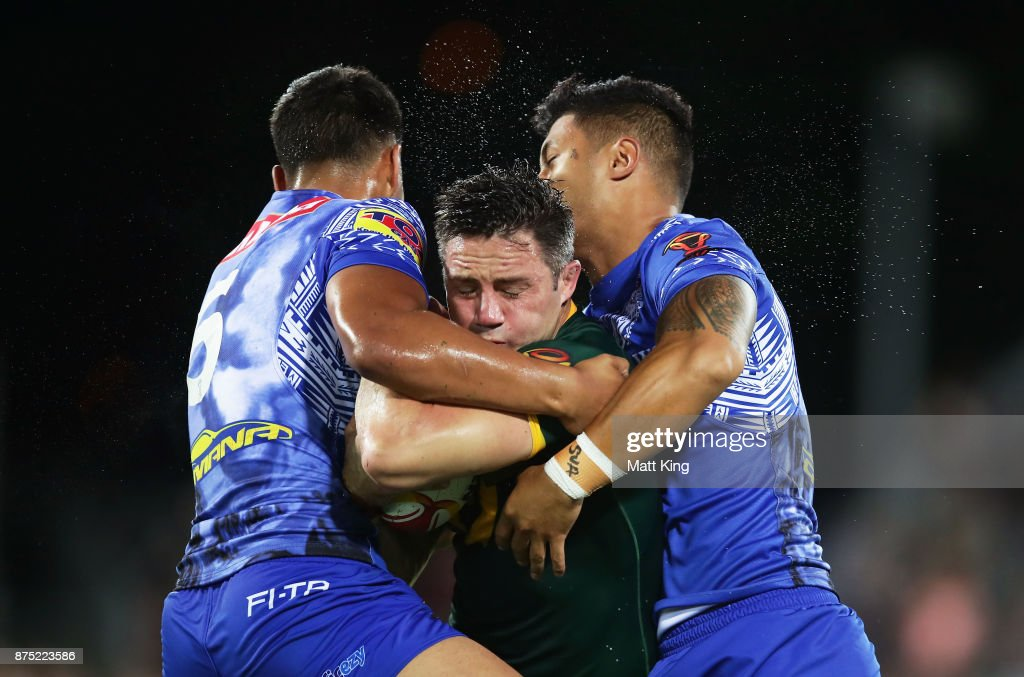 Cooper Cronk of Australia is tackled during the 2017 Rugby League World Cup Quarter Final match between Australia and Samoa at Darwin Stadium on November 17, 2017 in Darwin, Australia.