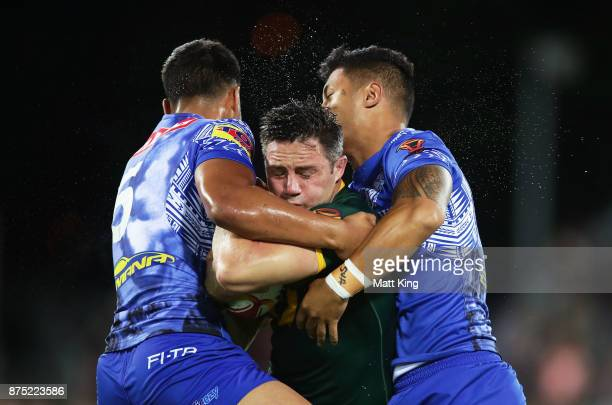 Cooper Cronk of Australia is tackled during the 2017 Rugby League World Cup Quarter Final match between Australia and Samoa at Darwin Stadium on...