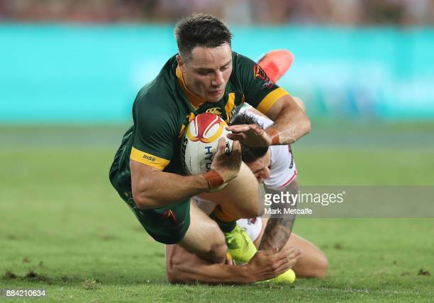 Cooper Cronk of Australia is tackled during the 2017 Rugby League World Cup Final between the Australian Kangaroos and England at Suncorp Stadium on...