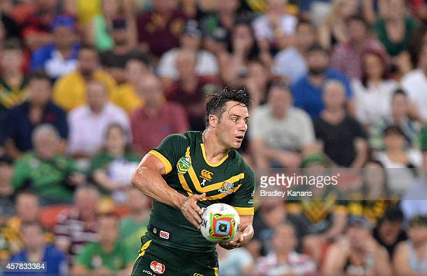 Cooper Cronk of Australia looks to pass during the Four Nations Rugby League match between the Australian Kangaroos and New Zealand Kiwis at Suncorp...