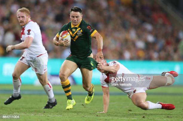 Cooper Cronk of Australia makes a break during the 2017 Rugby League World Cup Final between the Australian Kangaroos and England at Suncorp Stadium...
