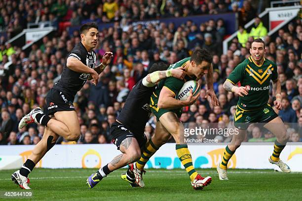 Cooper Cronk of Australia scores his sides second try as Kevin Locke and Shaun Johnson of New Zealand fail to challenge during the Rugby League World...
