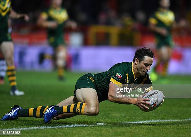 Cooper Cronk of Australia scores the first try during the Four Nations match between the Australian Kangaroos and Scotland at KCOM Lightstream...