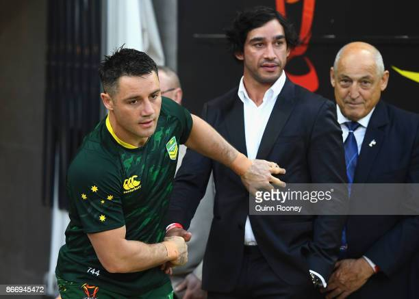 Cooper Cronk of Australia shakes hands with Johnathan Thurston as he runs out onto the field during the 2017 Rugby League World Cup match between the...