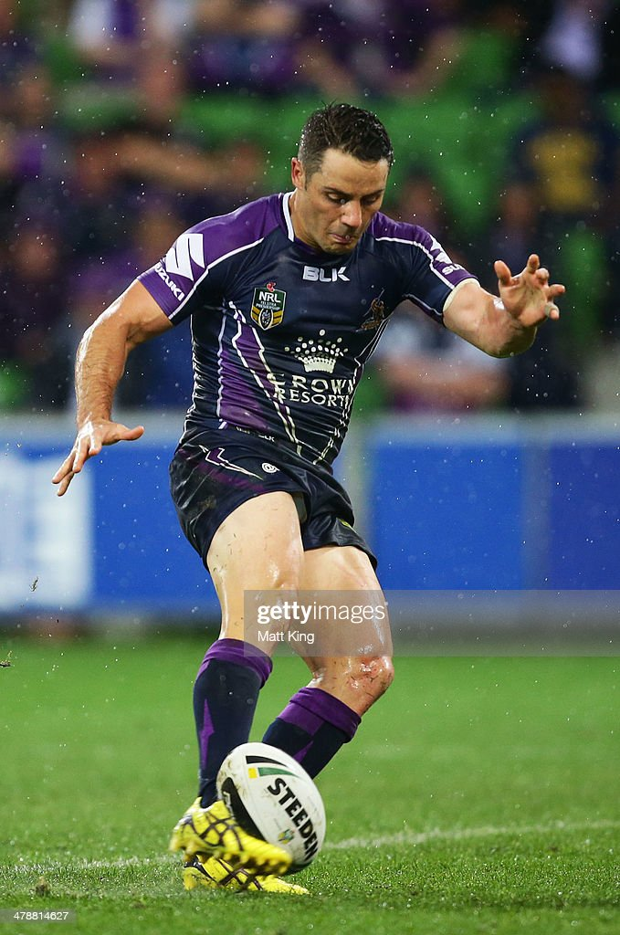 Cooper Cronk of Storm kicks the winning field goal during the round two NRL match between the Melbourne Storm and the Penrith Panthers at AAMI Park on March 15, 2014 in Melbourne, Australia.
