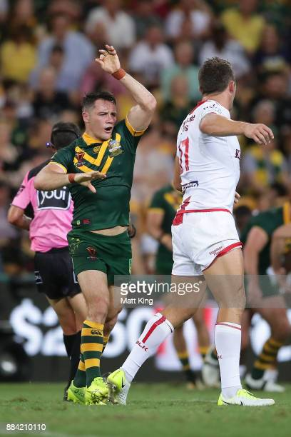 Cooper Cronk of the Kangaroos and Sam Burgess of England have words during the 2017 Rugby League World Cup Final between the Australian Kangaroos and...