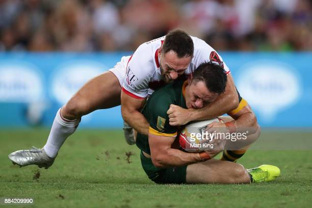 Cooper Cronk of the Kangaroos is tackled by Luke Gale of England during the 2017 Rugby League World Cup Final between the Australian Kangaroos and...