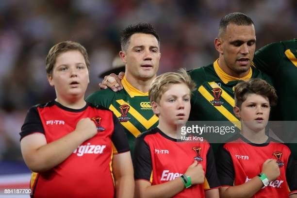 Cooper Cronk of the Kangaroos sings the national anthem before the 2017 Rugby League World Cup Final between the Australian Kangaroos and England at...