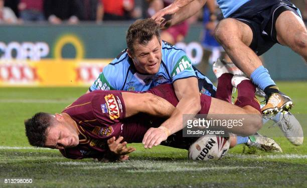 Cooper Cronk of the Maroons drops the ball over the tryline during game three of the State Of Origin series between the Queensland Maroons and the...