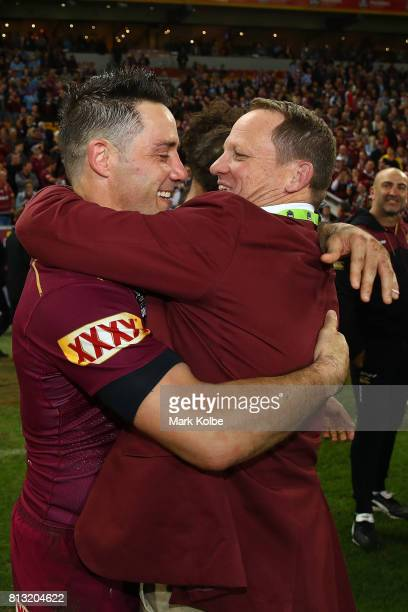 Cooper Cronk of the Maroons hugs coach Kevin Walters after winning game three of the State Of Origin series between the Queensland Maroons and the...