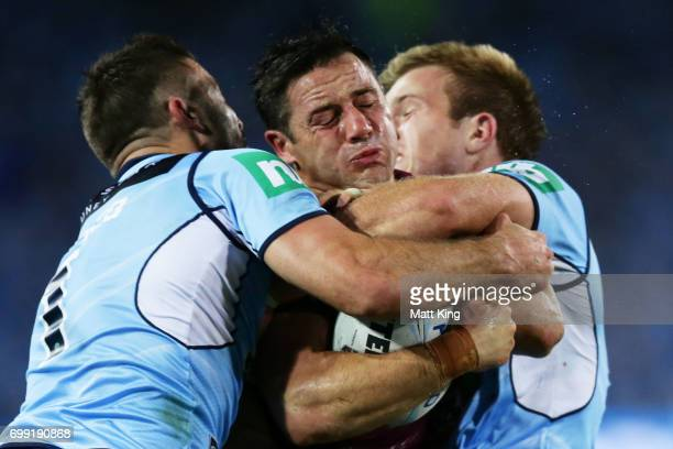 Cooper Cronk of the Maroons is tackled during game two of the State Of Origin series between the New South Wales Blues and the Queensland Maroons at...