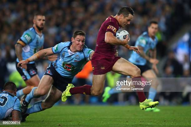 Cooper Cronk of the Maroons makes a break during game two of the State Of Origin series between the New South Wales Blues and the Queensland Maroons...