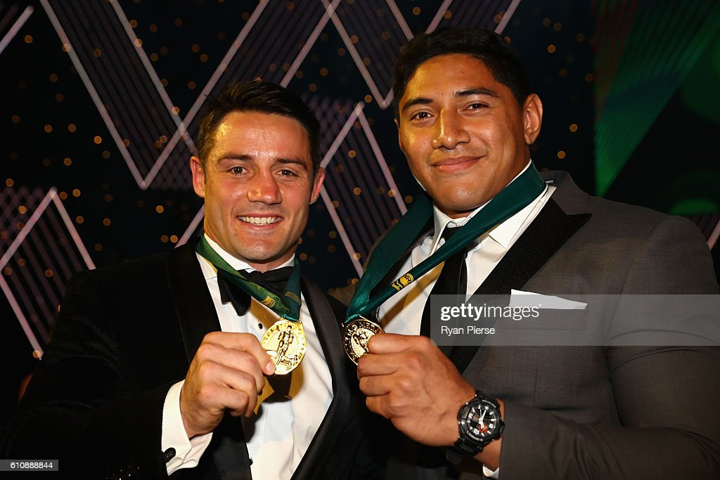 Cooper Cronk of the Melbourne Storm and Jason Taumalolo of the North Queensland Cowboys pose after being announced joint winners of the 2016 Dally M Medal during the 2016 Dally M Awards at Star City on September 28, 2016 in Sydney, Australia.