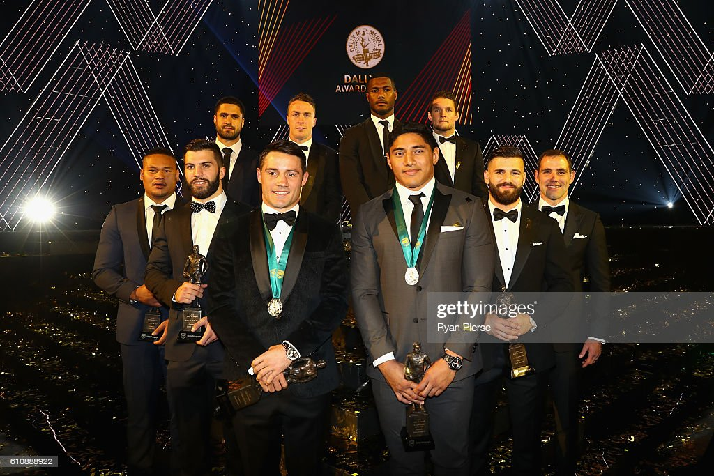 Cooper Cronk of the Melbourne Storm and Jason Taumalolo of the North Queensland Cowboys pose after being announced joint winners of the 2016 Dally M Medal, with other award winners from the 2016 NRL season during the 2016 Dally M Awards at Star City on September 28, 2016 in Sydney, Australia.