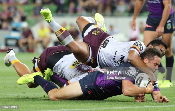 Cooper Cronk of the Melbourne Storm is tackled by Anthony Milford of the Broncos and falls just short of the try line during the round three NRL...