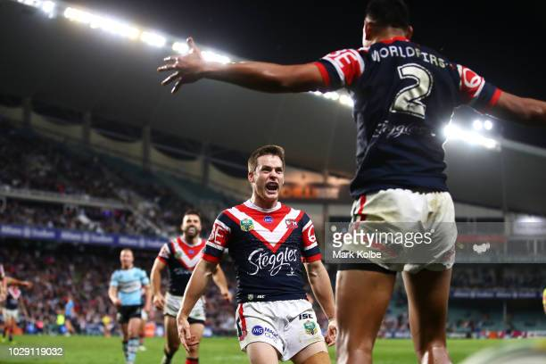 Cooper Cronk of the Roosters celebrates with Daniel Tupou of the Roosters after he scored a try during the NRL Qualifying Final match between the...