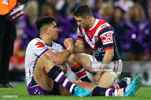 Cooper Cronk of the Roosters consoles Nelson AsofaSolomona of the Storm after the 2018 NRL Grand Final match between the Melbourne Storm and the...