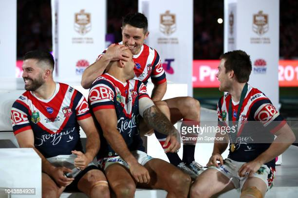 Cooper Cronk of the Roosters embraces team mate Blake Ferguson after winning the 2018 NRL Grand Final match between the Melbourne Storm and the...