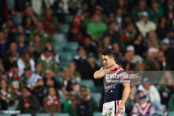 Cooper Cronk of the Roosters holds his shoulder during the NRL Preliminary Final match between the Sydney Roosters and the South Sydney Rabbitohs at...