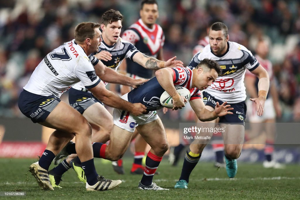 Cooper Cronk of the Roosters is tackled during the round 21 NRL match between the Sydney Roosters and the North Queensland Cowboys at Allianz Stadium on August 4, 2018 in Sydney, Australia.