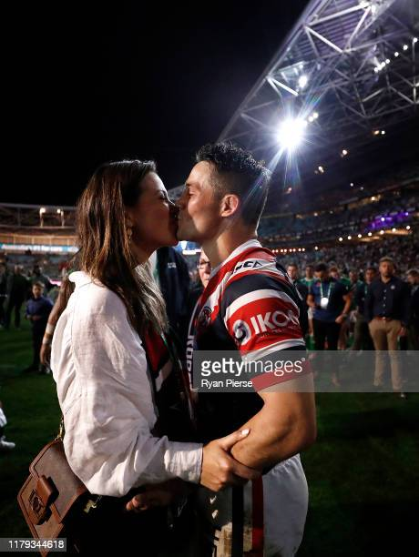 Cooper Cronk of the Roosters kisses his wife Tara Rushton after the 2019 NRL Grand Final match between the Canberra Raiders and the Sydney Roosters...