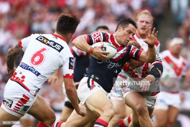 Cooper Cronk of the Roosters makes a break during the round eight NRL match between the St George Illawara Dragons and Sydney Roosters at Allianz...