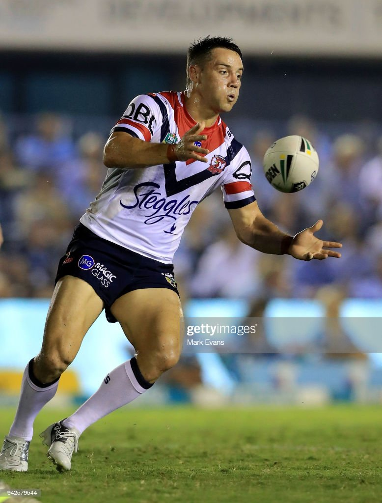 Cooper Cronk of the Roosters passes the ball during the round five NRL match between the Cronulla Sharks and the Sydney Roosters at Southern Cross Group Stadium on April 6, 2018 in Sydney, Australia.