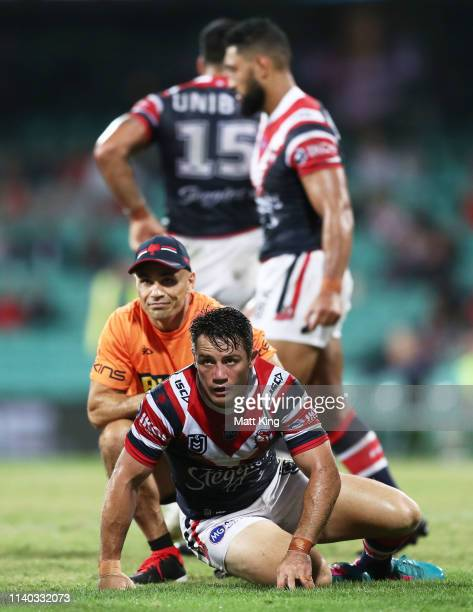 Cooper Cronk of the Roosters stays down after being hit late by Tevita Pangai Junior of the Broncos during the round four NRL match between the...