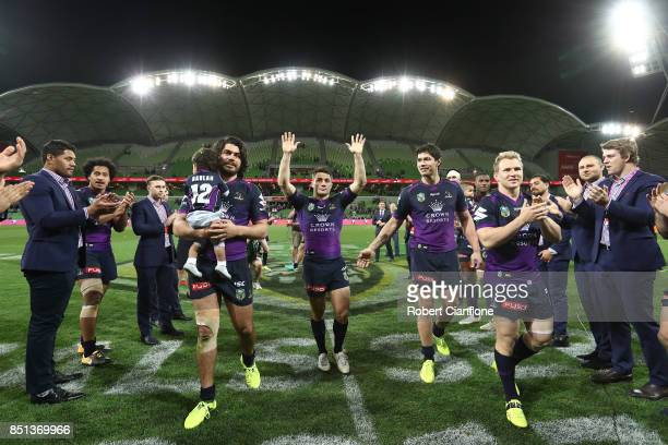 Cooper Cronk of the Storm acknowledges the crowd after playing his final match at home for the Storm during the NRL Preliminary Final match between...