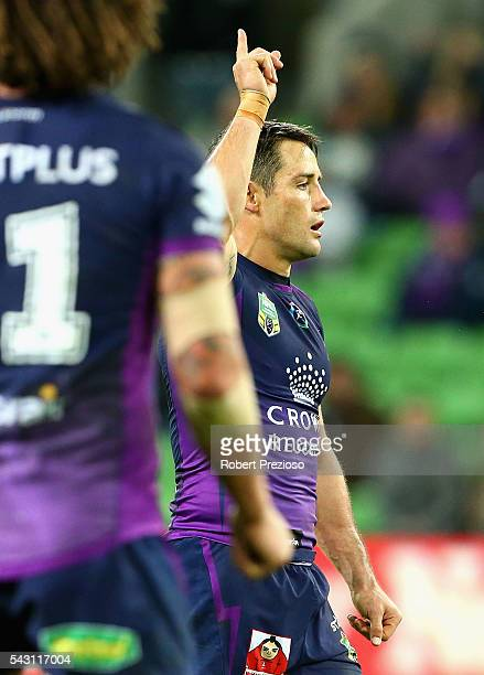 Cooper Cronk of the Storm celebrates after kicking a field goal during the round 16 NRL match between the Melbourne Storm and Wests Tigers at AAMI...