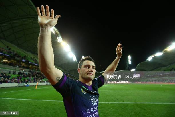 Cooper Cronk of the Storm celebrates after the Storm defeated the Broncos during the NRL Preliminary Final match between the Melbourne Storm and the...