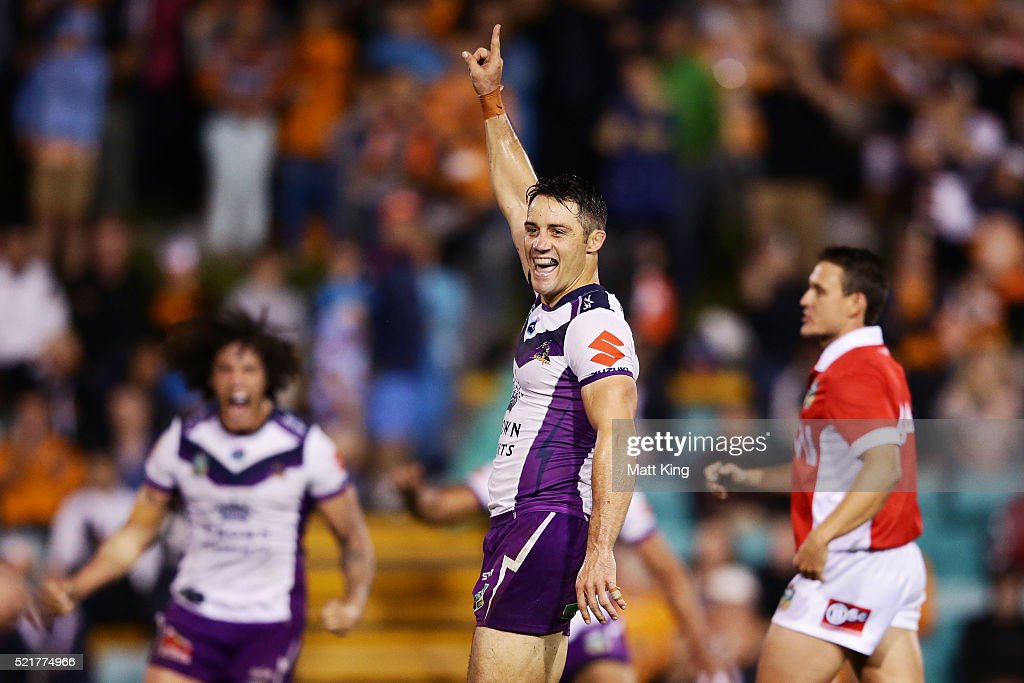 Cooper Cronk of the Storm celebrates kicking a field goal to win the match in golden point extra time during the round seven NRL match between the Wests Tigers and the Melbourne Storm at Leichhardt Oval on April 17, 2016 in Sydney, Australia.