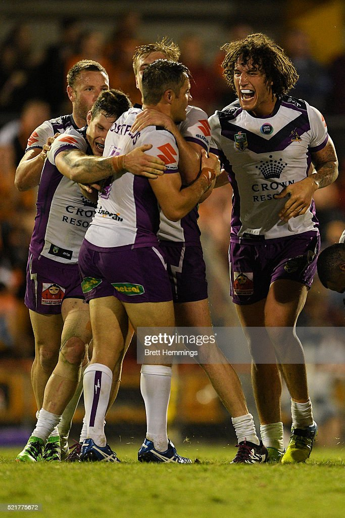 Cooper Cronk of the Storm celebrates with team mates after kicking the winning field goal in extra time during the round seven NRL match between the Wests Tigers and the Melbourne Storm at Leichhardt Oval on April 17, 2016 in Sydney, Australia.