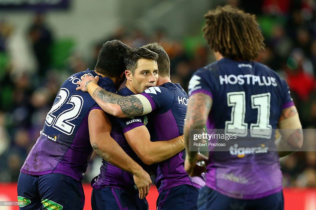 Cooper Cronk of the Storm celebrates with team-mates after kicking a field goal during the round 16 NRL match between the Melbourne Storm and Wests Tigers at AAMI Park on June 26, 2016 in Melbourne, Australia.