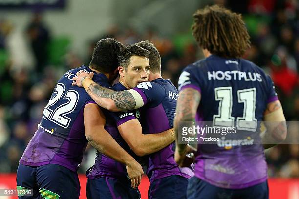 Cooper Cronk of the Storm celebrates with teammates after kicking a field goal during the round 16 NRL match between the Melbourne Storm and Wests...