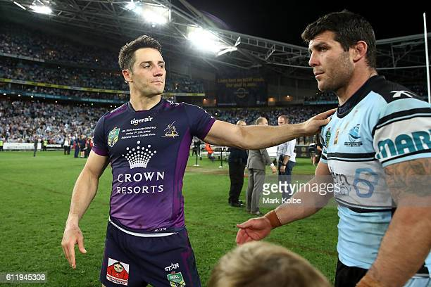 Cooper Cronk of the Storm congratulates Michael Ennis of the Sharks after the 2016 NRL Grand Final match between the Cronulla Sharks and the...
