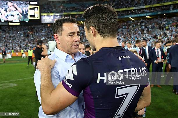 Cooper Cronk of the Storm congratulates Sharks coach Shane Flanagan after the 2016 NRL Grand Final match between the Cronulla Sharks and the...