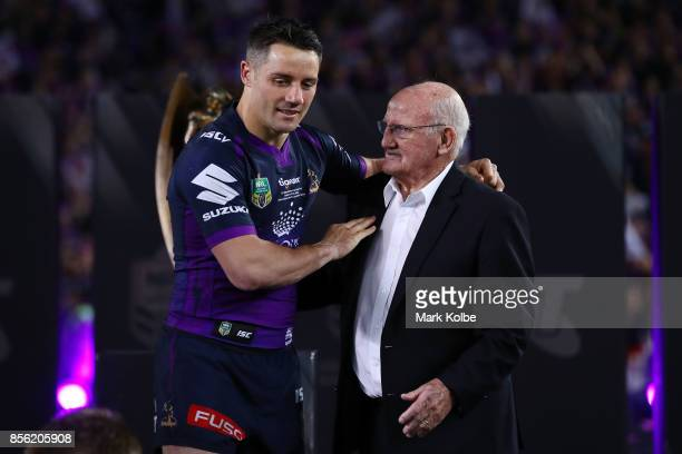 Cooper Cronk of the Storm is congratulated by Arthur Summons after the 2017 NRL Grand Final match between the Melbourne Storm and the North...