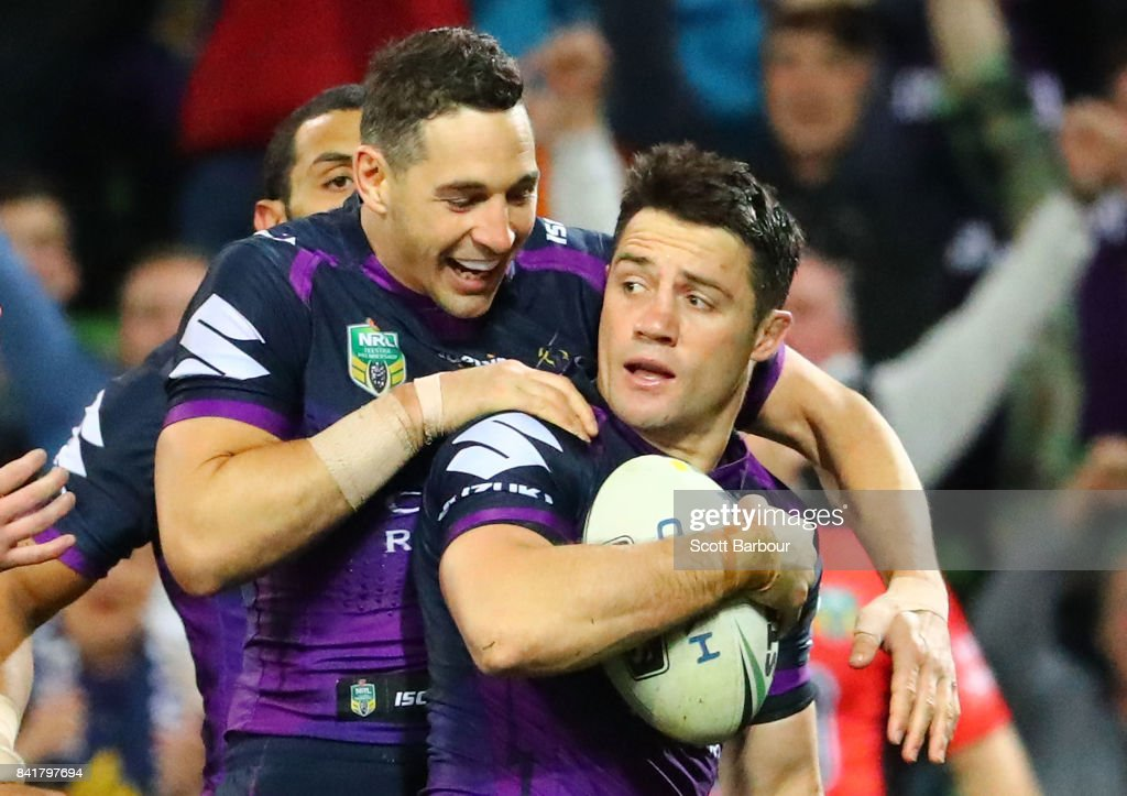 Cooper Cronk of the Storm is congratulated by Billy Slater after scoring a try which was later disallowed by the video referee for being off-side during the round 26 NRL match between the Melbourne Storm and the Canberra Raiders at AAMI Park on September 2, 2017 in Melbourne, Australia.