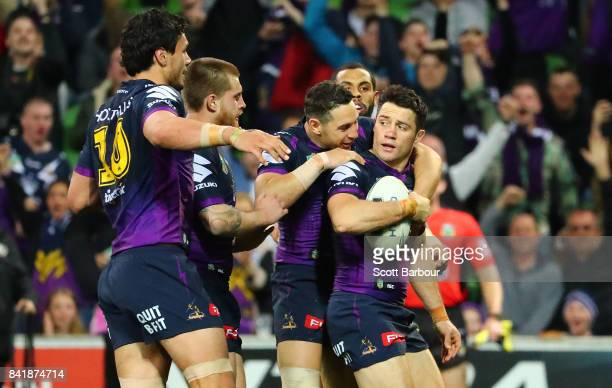 Cooper Cronk of the Storm is congratulated by Billy Slater after scoring a try which was later disallowed by the video referee for being offside...
