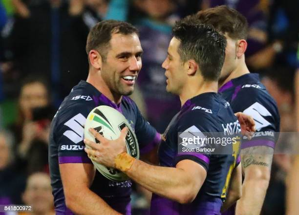 Cooper Cronk of the Storm is congratulated by Cameron Smith after scoring a try which was later disallowed by the video referee for being offside...