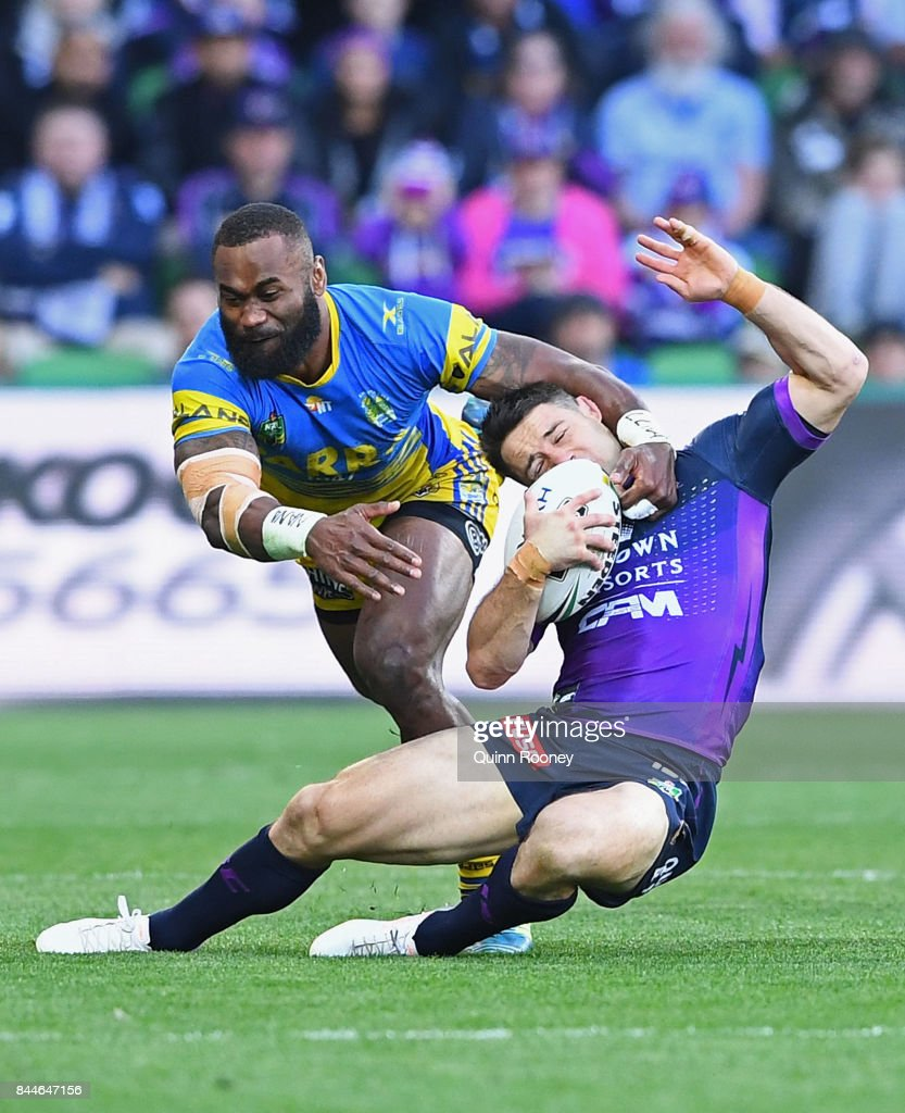 Cooper Cronk of the Storm is tackled by Semi Radradra of the Eels during the NRL Qualifying Final match between the Melbourne Storm and the Parramatta Eels at AAMI Park on September 9, 2017 in Melbourne, Australia.