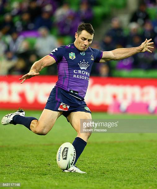 Cooper Cronk of the Storm kicks a field goal during the round 16 NRL match between the Melbourne Storm and Wests Tigers at AAMI Park on June 26 2016...