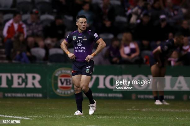 Cooper Cronk of the Storm looks dejected as he leaves the field after being given ten minutes in the sin bin during the round nine NRL match between...