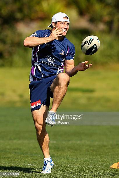 Cooper Cronk of the Storm passes the ball during a Melbourne Storm NRL training session at Gosch's Paddock on September 11, 2012 in Melbourne,...