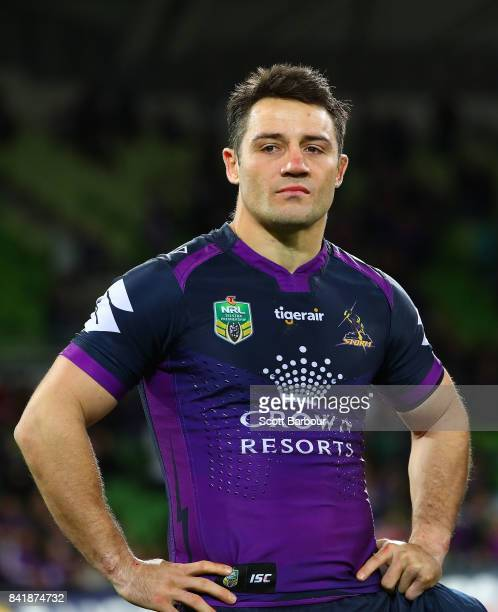 Cooper Cronk of the Storm reacts as he watches a highlights package on the big screen after he played his final home match after the round 26 NRL...