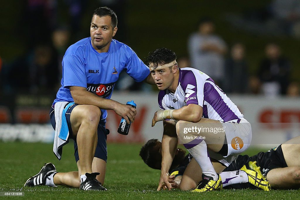Cooper Cronk of the Storm receives attention from the trainer during the round 24 NRL match between the Penrith Panthers and the Melbourne Storm at Sportingbet Stadium on August 25, 2014 in Sydney, Australia.