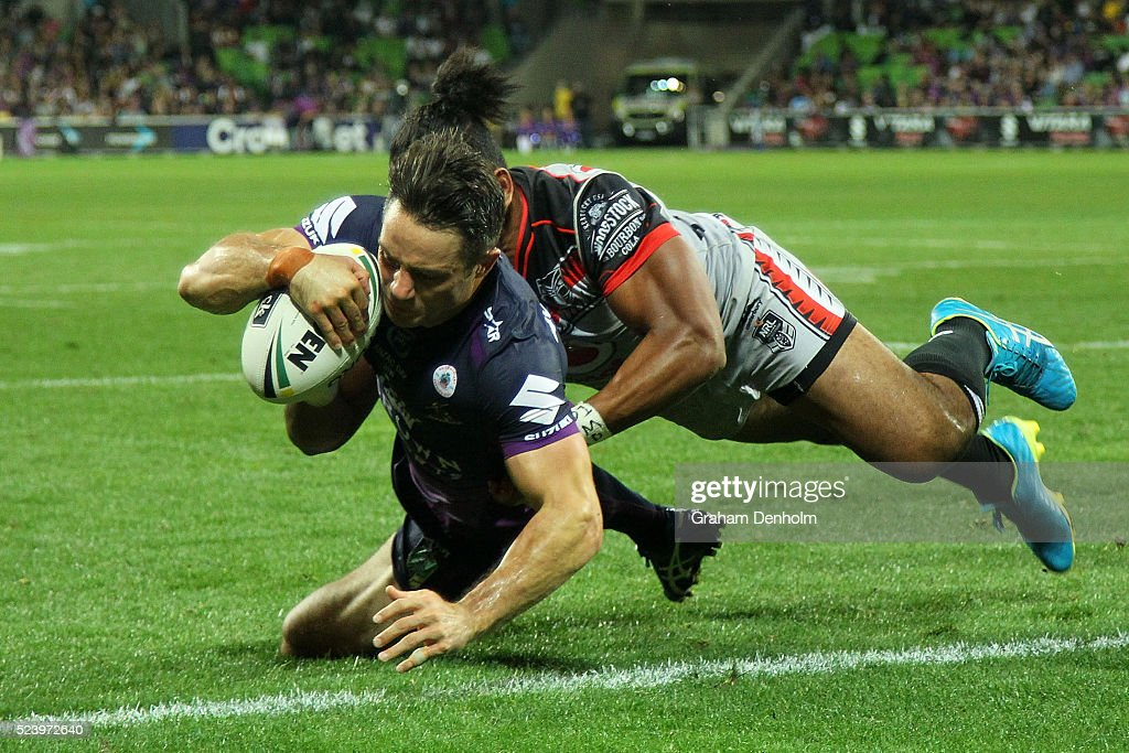 Cooper Cronk of the Storm scores a try during the round eight NRL match between the Melbourne Storm and the New Zealand Warriors at AAMI Park on April 25, 2016 in Melbourne, Australia.