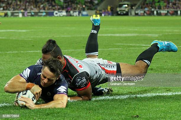 Cooper Cronk of the Storm scores a try during the round eight NRL match between the Melbourne Storm and the New Zealand Warriors at AAMI Park on...