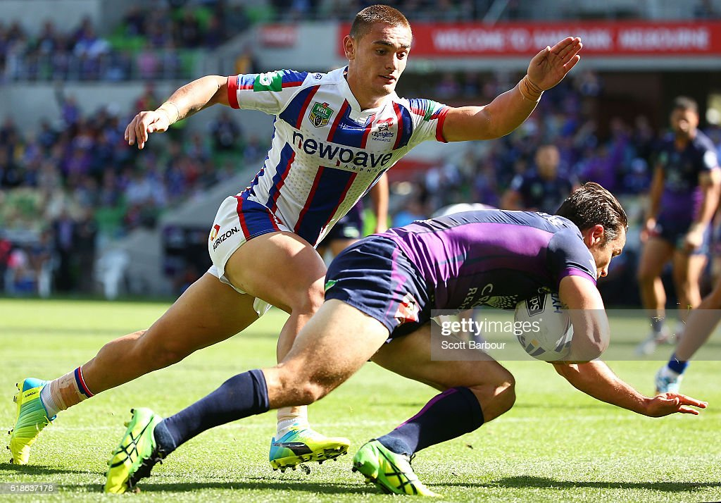 Cooper Cronk of the Storm scores a try during the round five NRL match between the Melbourne Storm and the Newcastle Knights at AAMI Park on April 2, 2016 in Melbourne, Australia.